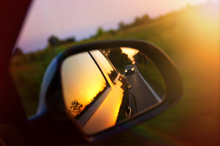 Driving at sunset - rear view mirror